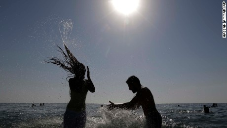 Inside The Middle East A Lebanese Couple Enjoy Themselves In The Water At The Beach Of The Southern Port City