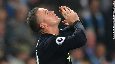 Wayne Rooney celebrates after scoring for Everton against Manchester City.