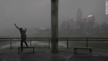 Strong winds hit the waterfront of Victoria Harbor on Wednesday in Hong Kong as Hato approaches.