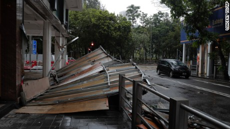 Typhoon Hato leaves a wooden wall collapsed Wednesday on a street in Hong Kong.
