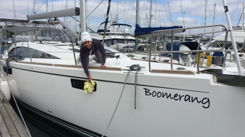 """Former CNN producer Kellie Pollock and her husband Jonathan gave up their jobs to sail around the world. Kellie gives their boat, """"Boomerang"""", a good polish before its maiden voyage."""