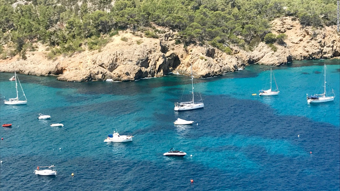 """Boomerang"" is pictured anchored in the middle of Cala San Miguel in Ibiza, the kind of idyllic setting they envisaged when they bought the boat."