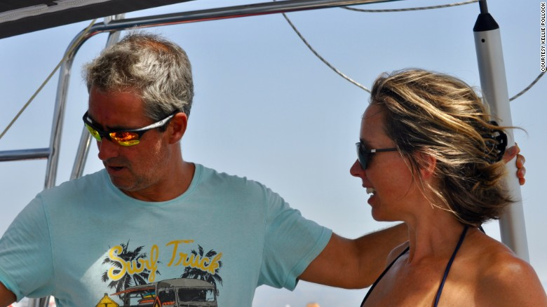 Jonathan hands over the helm to Kellie off the coast of Mallorca.
