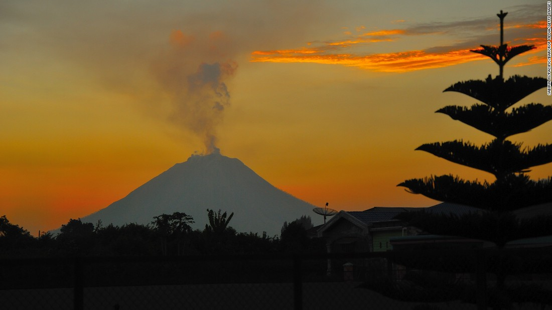 <strong>Kabanjahe, Indonesia: </strong>Mount Sinabung erupts on July 23, 2017,  sending clouds of ash and smoke up to four kilometers high. The volcano lay dormant for 400 years before it began erupting again in 2010.<br />