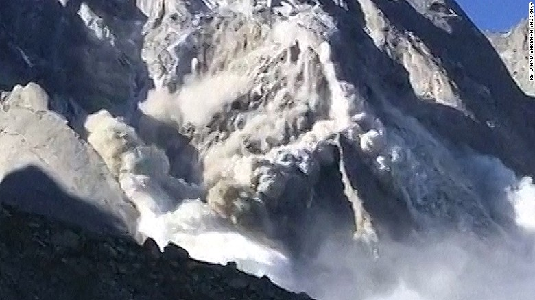 Moment landslide hurtles towards Swiss town