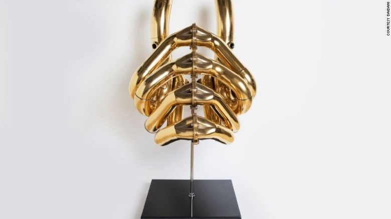 This piece is available to buy in Bitcoin at Dadiani Gallery in London. It's a sculpture made out of a used Formula 1 car engine.