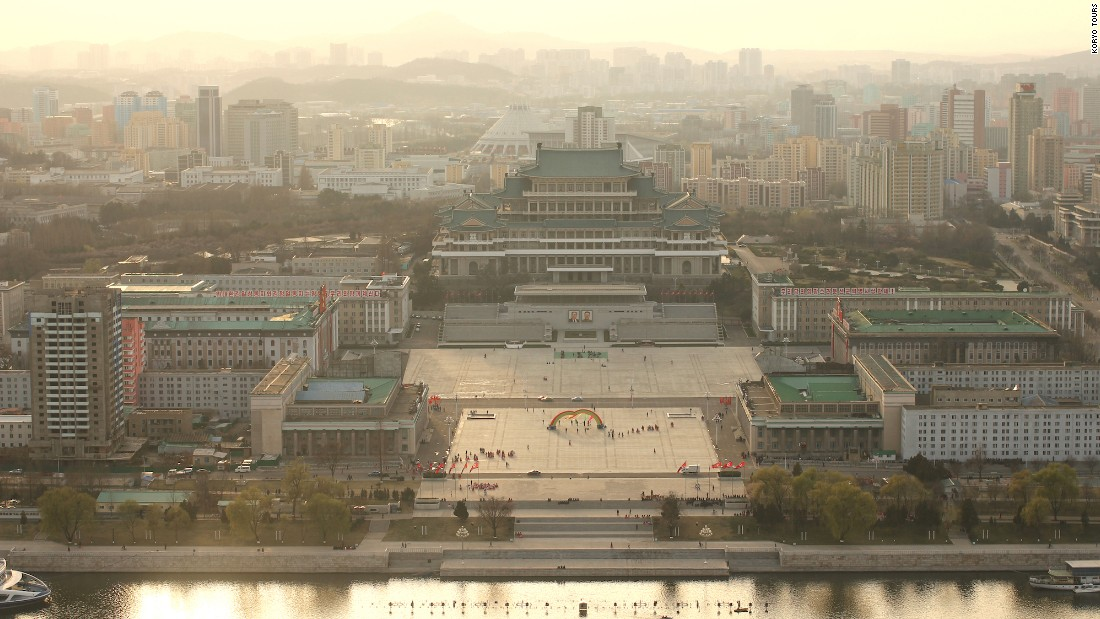 <strong>Lay of the land:</strong> Most travelers flying to North Korea begin the experience in the capital, Pyongyang. The city's Juche Tower provides a bird's-eye view of Kim Il Sung Square -- where military parades typically take place.