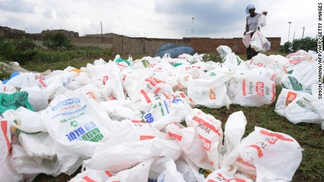 A woman sort out plastic bags after washing them for re-use at the shores of a river in Nairobi, Kenya.