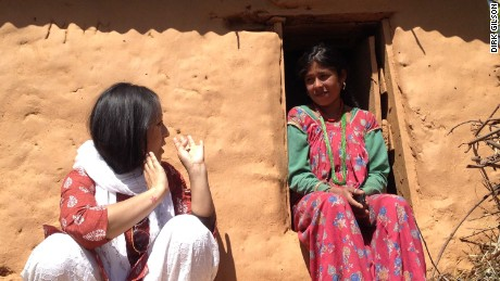 Menstrual Hygiene activist Pema Lakhi interacting with a local woman in Achham district of Nepal.