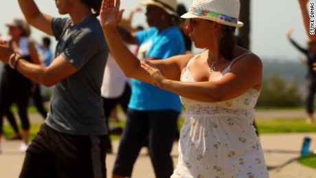 Taniela Irizarry, 37, takes a free tai chi class on Long Beach's Signal Hill.