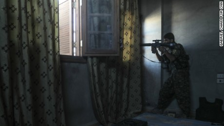 A SDF sniper targets Isis fighters in west Raqqa on August 25.