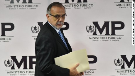 The head of the International Commission Against Impunity in Guatemala (CICIG), Ivan Velasquez of Colombia, arrives to a press conference with Guatemalan Attorney General Thelma Aldana (out of frame), in Guatemala City on August 25, 2017.  Guatemala's public prosecutor's office and CICIG, the United Nations commission against corruption, called Friday for President Jimmy Morales to be stripped of his immunity from prosecution, as he is suspected of irregularities during the 2015 election campaign that brought him to power. / AFP PHOTO / JOHAN ORDONEZ        (Photo credit should read JOHAN ORDONEZ/AFP/Getty Images)