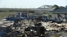 A burnt out house that caught fire after Hurricane Harvey hit Corpus Christi, Texas is seen on August 26, 2017.  Hurricane Harvey hit the Texas coast with forecasters saying its possible for up to 3 feet of rain and 125 mph winds.