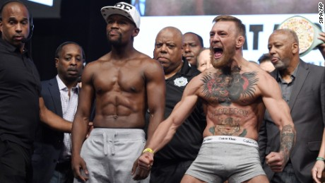 Floyd Mayweather Jr and Conor McGregor during the weigh in at the T-Mobile Arena, Las Vegas, Nevada on Friday August 25, 2017.