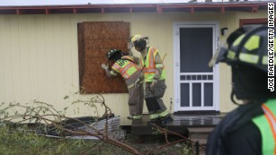 Rockport firefighters go door to door on a search and rescue mission as they look for people that may need help after Hurricane Harvey passed through on Saturday, August 26, in Rockport, Texas. Harvey made landfall shortly after 11 p.m. Friday, just north of Port Aransas, as a Category 4 storm and is being reported as the strongest hurricane to hit the United States since Wilma in 2005.