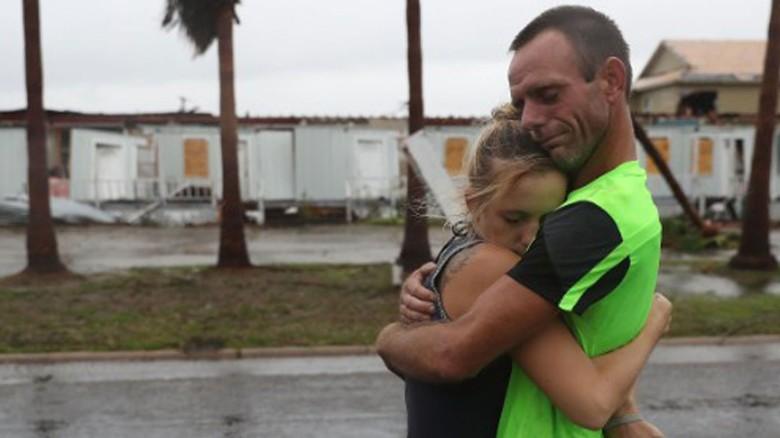 Residents of Rockport, Texas survey damage from Hurricane Harvey.