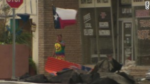 Symbol of hope: Resident waves Texas flag