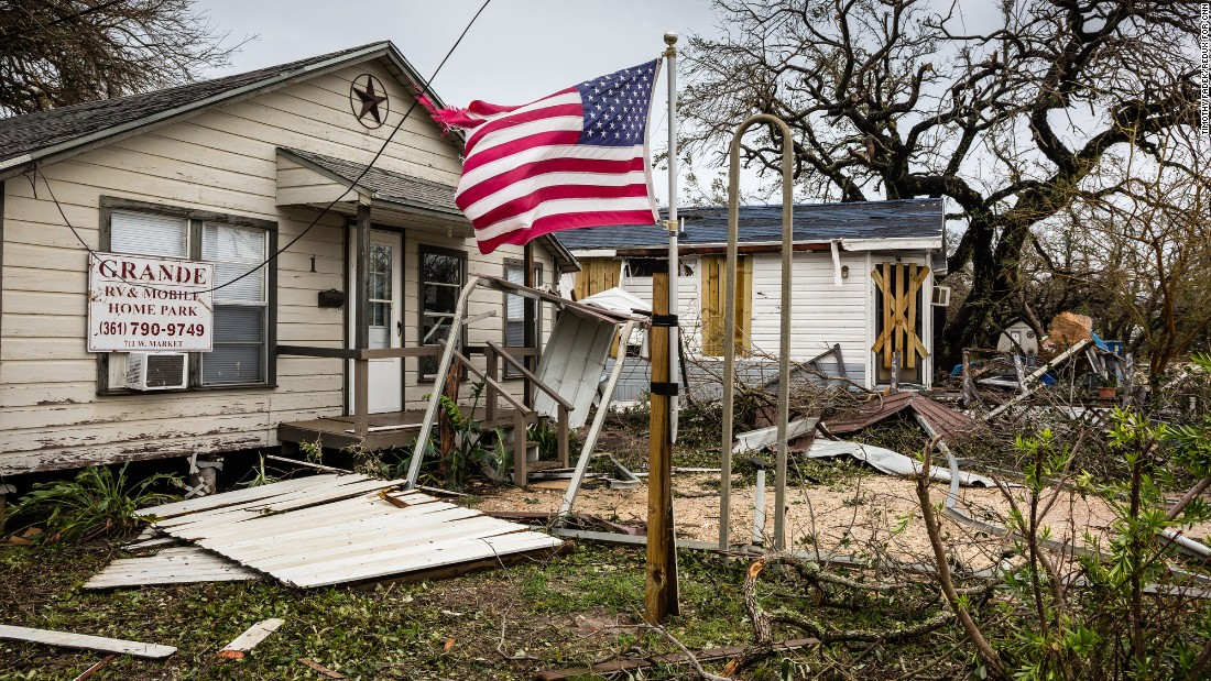 An American flag flies in front of a damaged mobile-home park in Rockport on August 26.