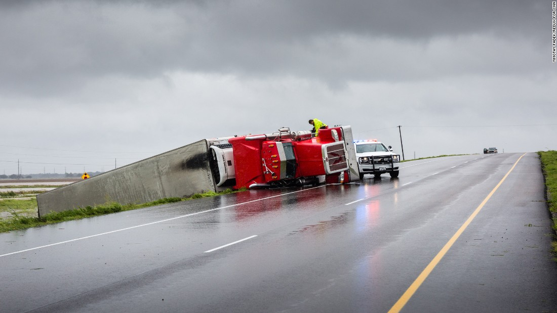 A semi-truck is overturned on a highway south of Houston on August 26.