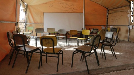 The makeshift tent-school in Jub-El-Thib has chairs but no tables.