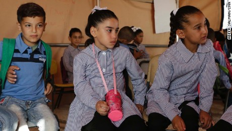 Jana Zawahra (c) attends class in a tent after her school was demolished in Jub El-Thib.