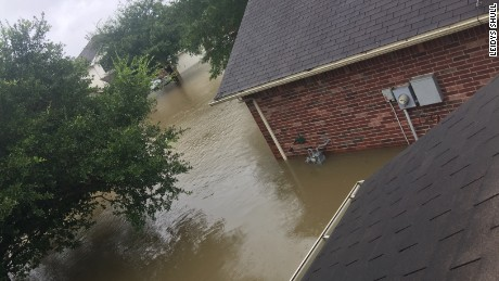 Leidys Shull and 10 family members are stuck on the second floor of their home in North Houston by rising flood waters. She says she can hear neighbors calling for help