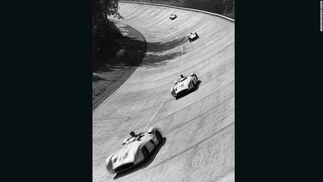 Monza's famous banking was constructed in 1954 and used four times for F1 races in 1955 (pictured with five-time F1 champion Juan Manuel Fangio leading the way), 1956, 1960 and 1961. It has since fallen derelict, but remains a treasured backdrop to modern races.