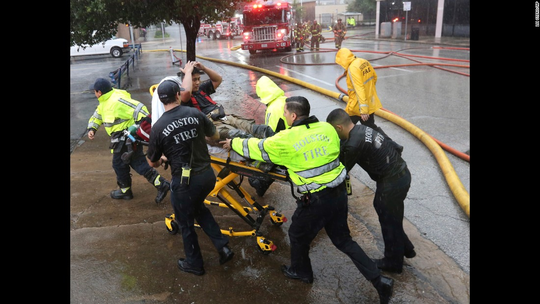 A firefighter is wheeled to a waiting ambulance after he became fatigued while fighting an office-building fire in downtown Houston on August 28.