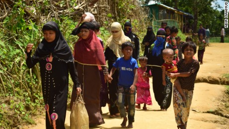 Amena Khatun (second from left) and her family enter Balukhali camp in Cox's Bazar.