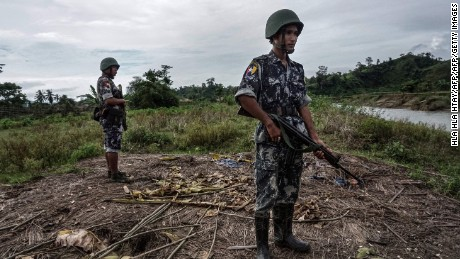 Border police standing guard at Tinmay village, Buthidaung township in Myanmar's northern Rakhine state.