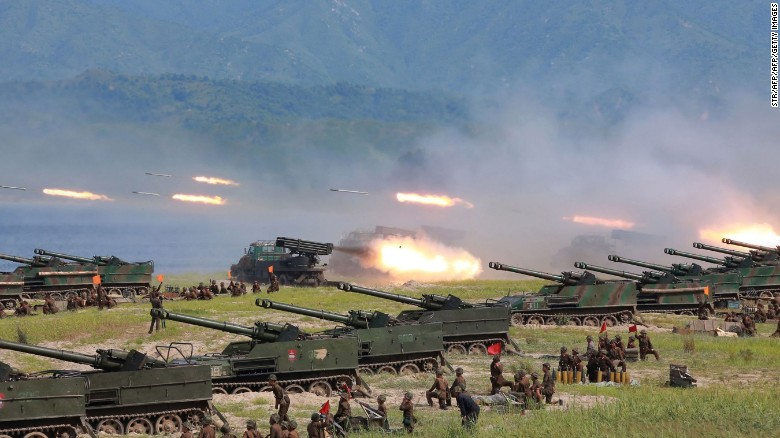 Photo released by North Korea's official Korean Central News Agency shows rockets being launched by Korean People's Army (KPA) personnel during a target strike exercise at an undisclosed location in North Korea.
