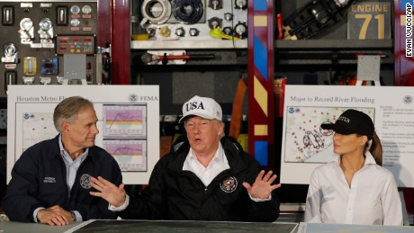 President Donald Trump, flanked by Texas Gov. Greg Abbott and first lady Melania Trump speaks during a briefing on Harvey relief efforts, Tuesday, Aug. 29, 2017, at Firehouse 5 in Corpus Christi, Texas. (AP Photo/Evan Vucci)