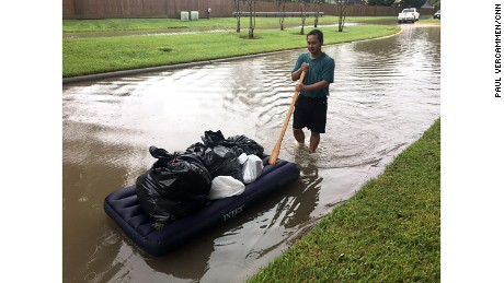 Steve Konemany pushes a mattress with belongings after the Addicks Reservoir overflowed Tuesday.