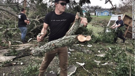 A  volunteer for First Response Team of America helps clear land in Texas