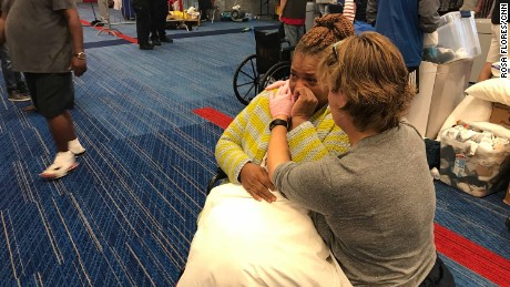 Harvey evacuee Karen Preston cries as she is given a pillow at Houston's convention center.