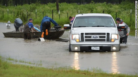 Civilian rescuers put their boat in the water on a flooded road to search for survivors in the aftermath of Hurricane Harvey in Cypress, Texas on August 29, 2017.