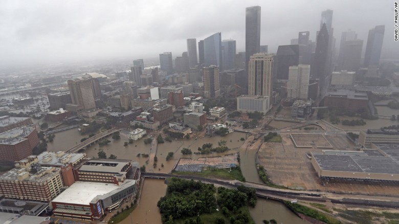 Houston residents wade into flooded streets