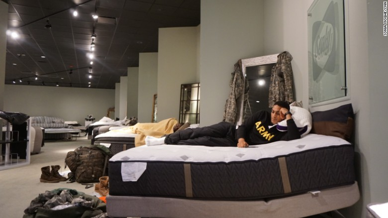 aziz shroff 23 with the texas national guard rests on a furniture store