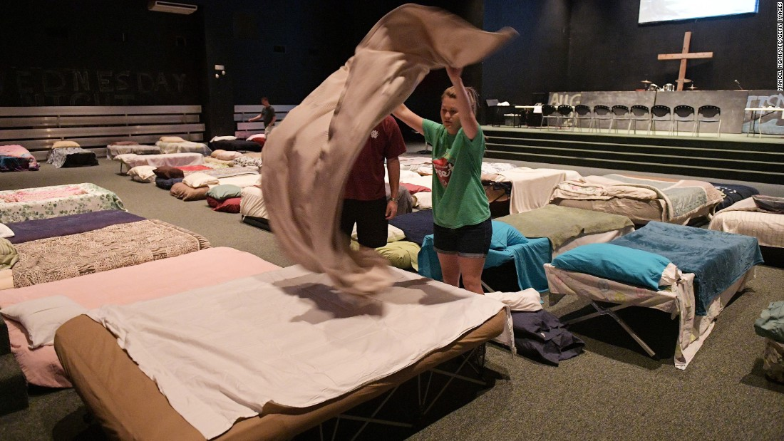 People set up a shelter for volunteer rescue workers at Fairfield Baptist Church in Cypress, Texas, on August 29.