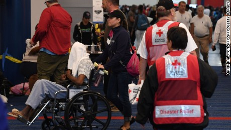 Evacuees arrive at the Convention Center which is housing people from flooded homes after Hurricane Harvey caused heavy flooding in Houston, Texas on August 29, 2017.   Harvey has set what forecasters believe is a new rainfall record for the continental US, officials said Tuesday. Harvey, swirling for the past few days off Texas and Louisiana has dumped more than 49 inches (124.5 centimeters) of rain on the region.  / AFP PHOTO / MARK RALSTON        (Photo credit should read MARK RALSTON/AFP/Getty Images)