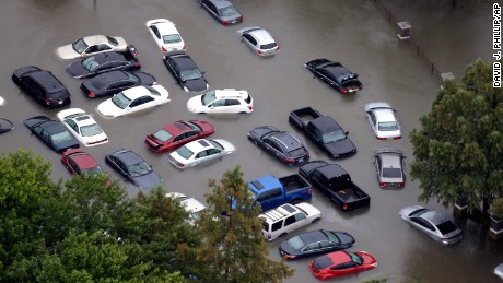 Floodwaters surround abandoned cars near the Addicks Reservoir in Houston on August 29.