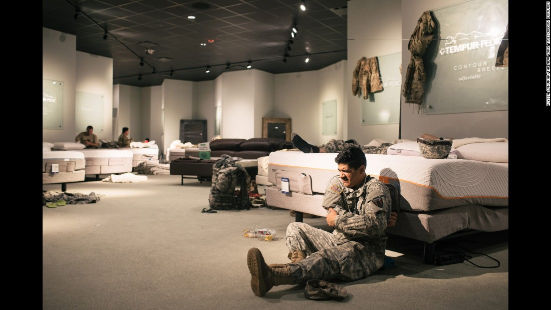 Members of the National Guard rest at a furniture store in Richmond, Texas, on August 29.