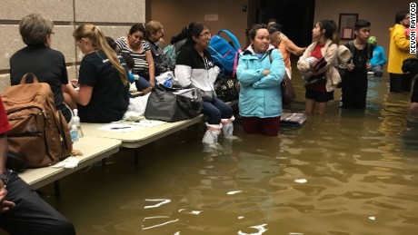 Evacuees at the Bob Bowers Civic Center in Port Arthur face flooding again as waters rise at the shelter.