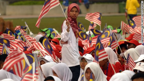 A Malaysian girl carries a national flag during an Independence Day parade rehearsals in Kuala Lumpur.