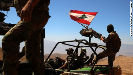 A picture taken on an army-organized press tour shows Lebanese army soldiers with the 6th Brigade driving their vehicules bearing the Lebanese flag on a hill recently taken from the Islamic State (IS) group in Jurud Ras Baalbeck on the Syrian-Lebanese border on August 28, 2017. / AFP PHOTO / PATRICK BAZ        (Photo credit should read PATRICK BAZ/AFP/Getty Images)
