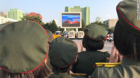 North Koreans watch missile launch