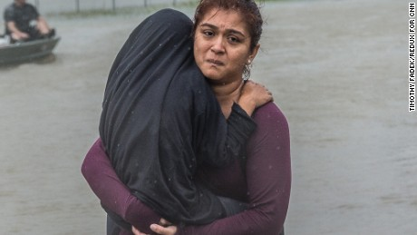 Houston residents who were trapped by severe flooding by   the heavy rain from tropical storm Harvey, are rescued and by boat and brought to safety, in Houston, Texas, Monday August 28, 2016