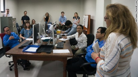 Cambodia Daily staff take part in an editorial meeting. The newspaper closed its doors after receiving a $6.3 million tax bill.