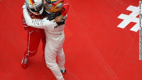 SHANGHAI, CHINA - APRIL 09:  Race winner Lewis Hamilton of Great Britain and Mercedes GP hugs second placed finisher Sebastian Vettel of Germany and Ferrari in parc ferme  during the Formula One Grand Prix of China at Shanghai International Circuit on April 9, 2017 in Shanghai, China.  (Photo by Clive Mason/Getty Images)