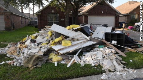 Debris and damaged items sit on the sidewalk after being removed from a home in the Twin Oaks Estate after Hurricane Harvey caused widespread flooding in Houston, Texas on August 31, 2017.   In Houston, America's fourth-largest city, some of the 2.3 million residents got relief as the raging waters receded. But in several other towns in the Lone Star State doused by days of torrential rains since Harvey smashed into the US Gulf Coast almost a week ago as a Category Four hurricane, the situation was dire.  / AFP PHOTO / MARK RALSTON        (Photo credit should read MARK RALSTON/AFP/Getty Images)